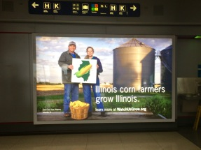 A sign advertising corn growers inside the Chicago airport.