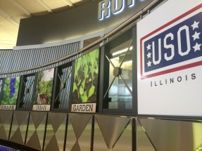 Signs for the Ohare Urban Garden inside the Chicago airport.